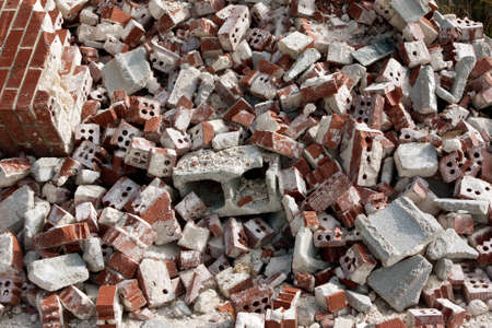 discarded: Huge pile of discarded broken bricks and cinder blocks at demolition site