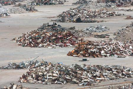 trashed: Piles of twisted metal, broken concrete and debris litter a demolition site.
