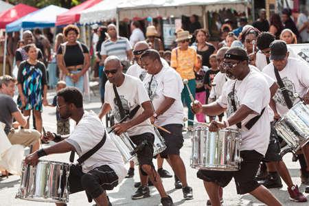 energized: Atlanta, GA, USA - September 12, 2015:  Members of the Atlanta Ol Skool Drummers perform on the street at the 5 Arts Fest in Atlanta.