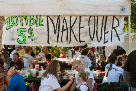 gore: Canton, GA, USA - October 17, 2015:  Makeup artists give people zombie makeovers for 5 at the Cherokee Zombie Fest in Canton, GA. Editorial
