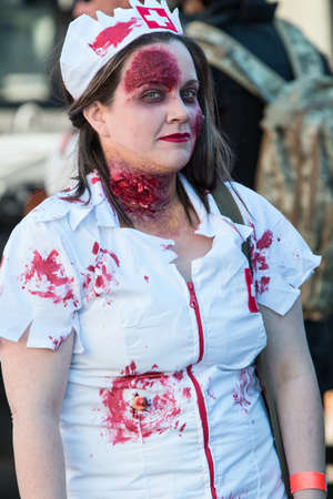 Canton, GA, USA - October 17, 2016:  A woman wears a bloody nurse outfit and zombie makeup as she takes part in the annual Cherokee Zombie Fest in Canton, GA.