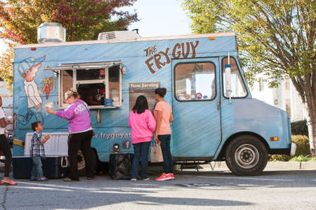 food industry: Canton, GA, USA - October 17, 2015:  People buy food from a food truck at the Cherokee Zombie Fest in Canton, GA.