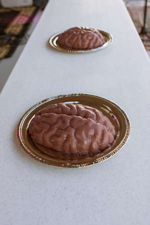 cherokee: Plates of frozen jello molded to look like human brains, await the contestants in a brain eating contest at the Cherokee Zombie Fest in Canton, GA. Stock Photo