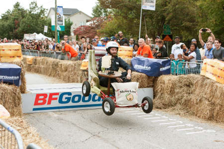 Atlanta, GA, USA - October 24, 2015:  A competitor driving a living room chair vehicle gets airborne off a ramp at the Red Bull Soap Box Derby on North Avenue in Atlanta, GA. Editorial
