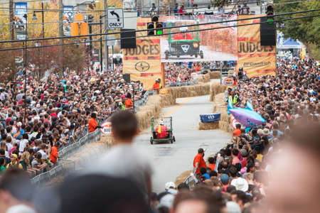Atlanta, GA, USA - October 24, 2015:  Thousands of spectators watch competitors race in the Red Bull Soap Box Derby on North Avenue in Atlanta, GA.
