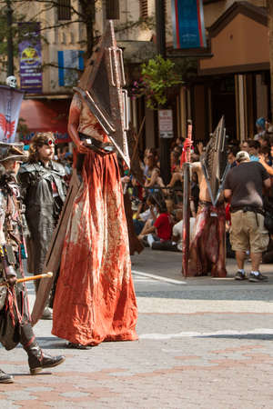con man: Atlanta, GA, USA - September 5, 2015:  A man on stilts wears a scary bloodstained costume as he walks in the annual Dragon Con parade in Atlanta, GA.