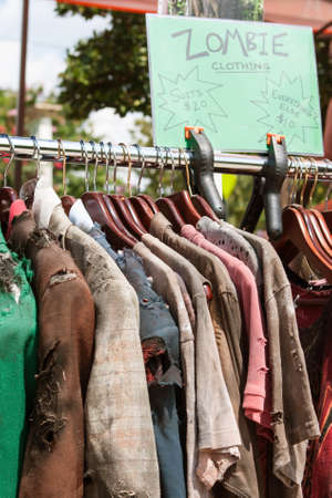 ripped metal: Rack Of Zombie Clothes On Sale At Atlanta Pub Crawl Stock Photo