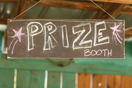 grassroots: Handmade sign reads Prize Booth at grassroots carnival.