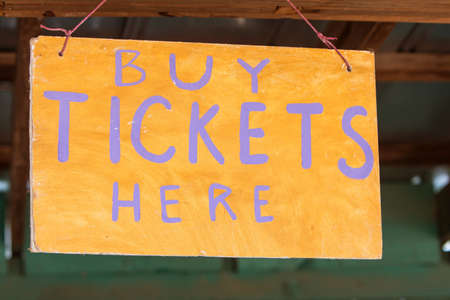 grassroots: Handmade sign reads Buy Tickets Here at grassroots carnival.