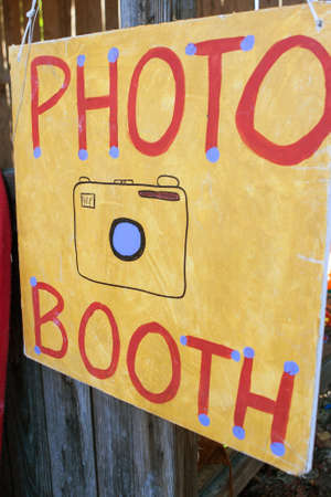 grassroots: Handmade sign reads Photo Booth at grassroots carnival.