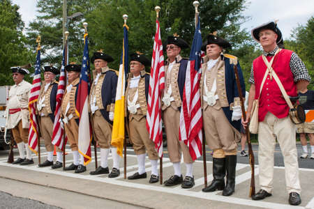 period costume: Alpharetta, GA, USA - August 1, 2015:  Members of the Sons of the American Revolution stand ready to present colors at the start of the Old Soldiers Day Parade in Alpharetta, GA on August 1, 2015. Editorial