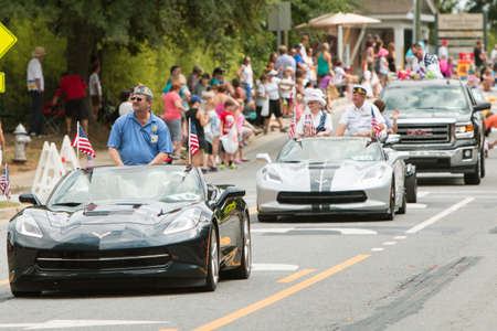 ga: Alpharetta, GA, USA - August 1, 2015:  Veterans ride in convertibles along the parade route of the annual Old Soldiers Day Parade in Alpharetta, GA on August 1, 2015.