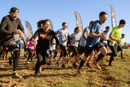 brute: Buford, GA, USA - November 21, 2015:  Competitors take off running from the start line of the Muddy Brute Challenge obstacle course race in Buford, GA on November 21, 2015.