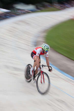 East Point, GA, USA - August 29, 2015:  Motion blur of pro cyclist sprinting during his time trial at the Dick Lane Velodrome in East Point, GA on August 29, 2015.