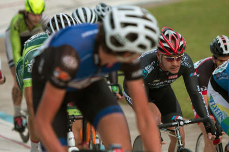 at close quarters: East Point, GA, USA - August 29, 2015:  A group of pro cyclists bunch up as they wait to begin their sprint in a race at the Dick Lane Velodrome on August 29, 2015 in Atlanta, GA. Editorial
