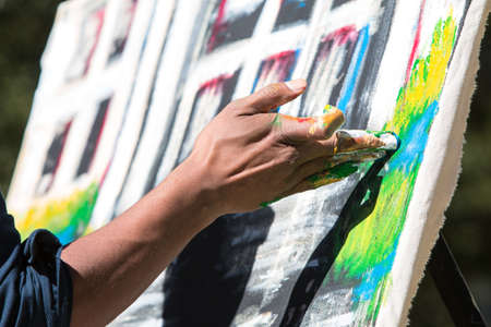 woodruff: Atlanta, GA, USA - October 17, 2015:  An artist paints with his fingers in the Elevate Art festival at Woodruff Park on October 17, 2015 in Atlanta, GA.