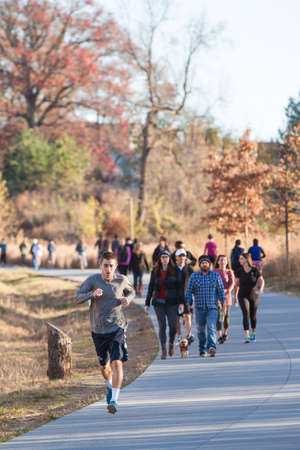recreational area: Atlanta, GA USA - December 5, 2015:  People walk and run along the Atlanta Beltline recreational area in the Old Fourth Ward on December 5, 2015 in Atlanta, GA.