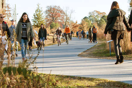 recreational area: Atlanta, GA USA - December 5, 2015:  People walk, run and bike along the Atlanta Beltline recreational area in the Old Fourth Ward on December 5, 2015 in Atlanta, GA. Editorial