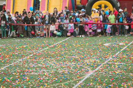 cordoned: Marietta, GA, USA - March 26, 2016:  Children and families eagerly await the start of a massive community Easter egg hunt on the football field of Sprayberry High School on March 26, 2016 in Marietta, GA.