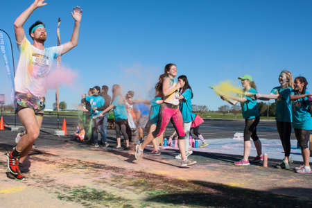 starch: Hampton, GA, USA - April 2, 2016:  Runners get covered with colored corn starch at The Color Run on April 2, 2016 in Hampton, GA.