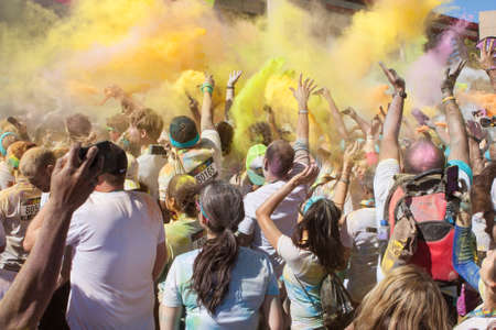 adrenaline rush: Hampton, GA, USA - April 2, 2016:  A large crowd of runners who completed the Color Run, toss packets of colored corn starch into the air, creating an organic explosion of colors over the group on April 2, 2016 in Hampton, GA. Editorial