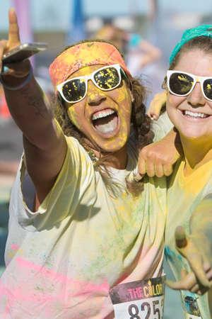 adrenaline rush: Hampton, GA, USA - April 2, 2016:  Female runners covered in colored corn starch celebrate finishing The Color Run on April 2, 2016 in Hampton, GA.