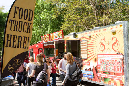 Atlanta, GA, USA - April 16, 2016:  A sign announces the presence of food trucks to a crowd attending the Food-o-rama festival in Grant Park on April 16, 2016 in Atlanta, GA.
