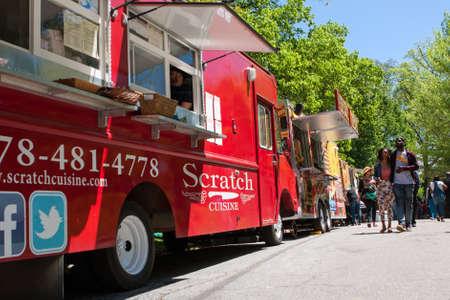 Atlanta, GA, USA - April 16, 2016:  People walk among 30 food trucks lined up in Grant Park at the Food-o-rama festival on April 16, 2016 in Atlanta, GA. Editorial