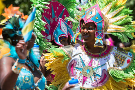 arousing: Atlanta, GA, USA - May 28, 2016:  Women wearing elaborate feathered costumes walk in a parade to celebrate Caribbean culture along North Avenue on May 28, 2016 in Atlanta, GA. Editorial
