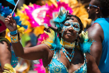 Atlanta, GA, USA - May 28, 2016:  A woman wearing an elaborate costume and mask participates in a parade celebrating Caribbean culture on North Avenue on May 28, 2016 in Atlanta, GA. Editorial