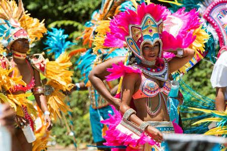 Atlanta, GA, USA - May 28, 2016:  Young women wearing elaborate costumes and feathered headdresses walk in a parade to celebrate Caribbean culture along North Avenue on May 28, 2016 in Atlanta, GA. Editorial