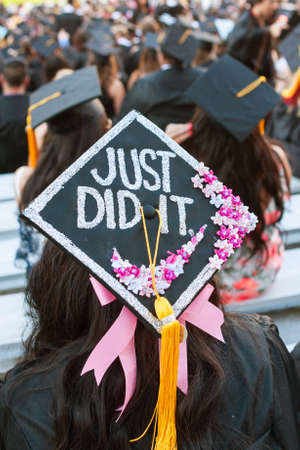 Athens, GA, USA - May 13, 2016:  A female University of Georgia student wears a cap that says Just Did It at UGAs graduation ceremony on May 13, 2016 in Athens, GA. Editorial