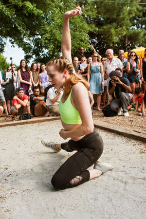 Atlanta, GA, USA - August 6, 2016:  A young female dancer with the Atlanta Ballet puts on a Wabi Sabi dance performance for the general public at a spot along the Atlanta Beltline Greenspace on August 6, 2016 in Atlanta, GA.