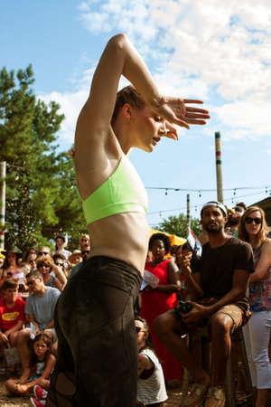 Atlanta, GA, USA - August 6, 2016:  A young female dancer with the Atlanta Ballet puts on a Wabi Sabi dance performance for onlookers along the Atlanta Beltline Greenspace on August 6, 2016 in Atlanta, GA.