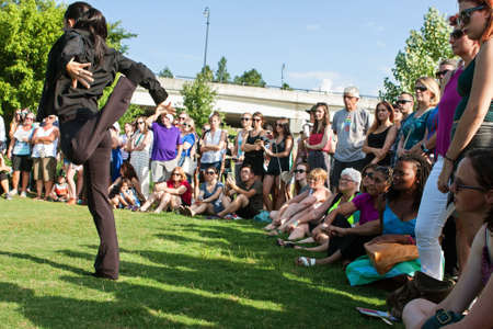 sabi: Atlanta, GA, USA - August 6, 2016:  A female dancer with the Atlanta Ballet puts on a Wabi Sabi dance performance for onlookers at a public park along the Atlanta Beltline Greenspace on August 6, 2016 in Atlanta, GA.