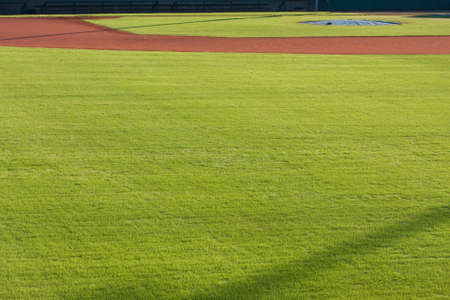 outfield: Generic scene of infield dirt and outfield grass of baseball field.  Stock Photo
