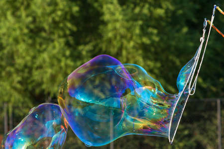 Large Bubbles Form From Soapy Bubble Wand Stock Photo