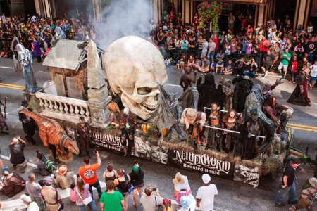 promotes: Atlanta, Ga, USA - September 3, 2016:  A huge parade float with a giant human skull promotes a haunted house as it travels down the parade route of the annual Dragon Con parade on September 3, 2016 in Atlanta, GA.