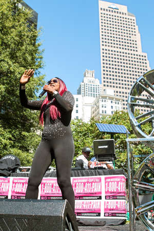 rapping: Atlanta, GA, USA - October 8, 2016:  Female hip hop artist Knocka DonDiva performs on the stage at Atlanta Hip Hop Day, a free festival open to the public at Woodruff Park in downtown Atlanta, on October 8, 2016 in Atlanta, GA.