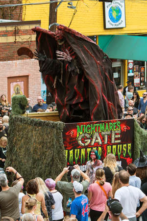 hydraulics: Atlanta, GA, USA - October 15, 2016:  A terrifying demonic monster rises up via hydraulics on a parade float promoting a haunted house at the annual Little Five Points Halloween parade, on October 15, 2016 in Atlanta, GA.