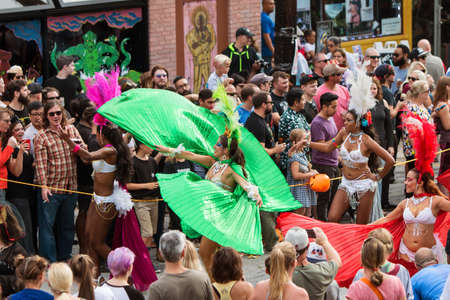 Atlanta, GA, USA - October 15, 2016:  Female Brazilian dancers twirl their capes while dancing along the parade route of the annual Little Five Points Halloween parade, on October 15, 2016 in Atlanta, GA.