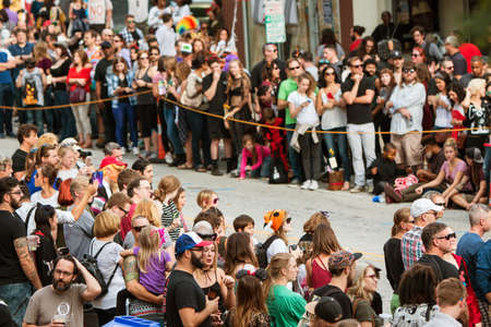 cordoned: Atlanta, GA, USA - October 15, 2016:  Hundreds of spectators line the parade route as they wait for the start of the annual Little Five Points Halloween parade, on October 15, 2016 in Atlanta, GA.