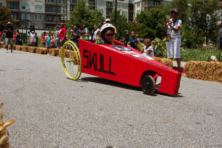 Atlanta, GA, USA - August 13, 2016:  A kid steers his homemade car downhill in the Cool Dads Rock Soap Box Derby in the Old Fourth Ward, on August 13, 2016 in Atlanta, GA. Editorial