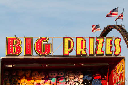 Lawrenceville, GA, USA - September 17, 2016:  Big Prizes sign sits atop carnival game filled with stuffed animals at the Gwinnett County Fair, on September 17, 2016 in Lawrenceville, GA.