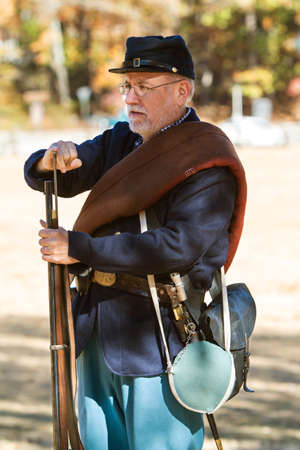 Kennesaw, GA, USA - November 20, 2016:  A Civil War reenactor wearing a union uniform demonstrates how to load a musket at a firing demonstration put on at Kennesaw Mountain National Battlefield Park, on November 20, 2016 in Kennesaw, GA.