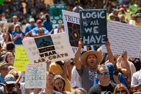 Atlanta, GA, USA - March 22, 2017:  Thousands of people crowd Candler Park and hold up signs as they take part in a rally preceding the Atlanta March for Science on Earth Day on April 22, 2017 in Atlanta, GA.