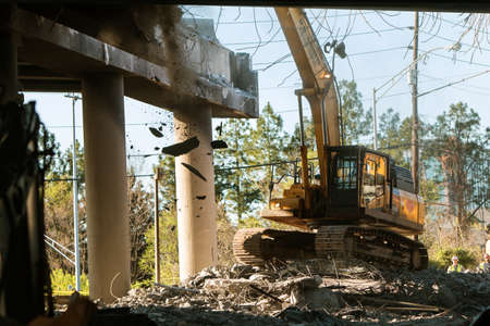 Atlanta, GA, USA - April 1, 2017:  A crane knocks down a section of I-85 South just imploded, following the collapse of the I-85 North bridge from a fire, on April 1, 2017 in Atlanta, GA. Editorial