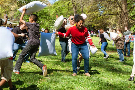 Atlanta, GA, USA - April 1, 2017:  People have fun hitting each other with pillows on International Pillow Fight Day, in Grant Park on April 1, 2017 in Atlanta, GA.
