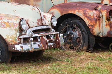 Rusted autos sit in a North Georgia junkyard Stock Photo