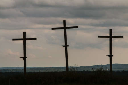 Three crosses in a North Georgia field stand against an ominous sky.